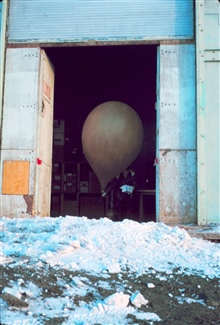 Preparing a meteorological balloon for launching at McMurdo Station.
