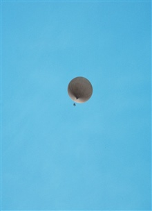 Meteorological balloon with instrument package swinging below at McMurdoStation.