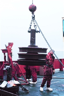 Deploying the trainwheel anchor for a mooring in the Ross Sea.