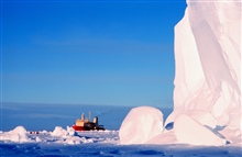 The Ross Ice Shelf at the Bay of Whales.  Research Vessel Ice Breaker (RVIB)NATHANIEL B. PALMER in the background.