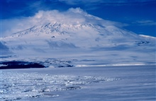 Mount Erebus on Ross Island from the deck of the NATHANIEL B. PALMER.77 32 S Latitude  167 10 E Longitude.
