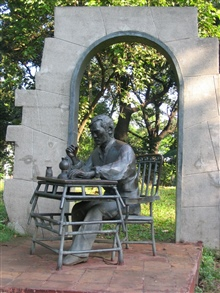 Statue of Dr. Rizal, a Philippine independence fighter, at table in his cellprior to being executed.  This statue is in Rizal Park.