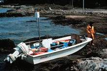 Boston whaler secured on shore in Deer Island Passage.Note Motorola Miniranger on mast - used for navigation.Whaler outfitted for hydrographic work.