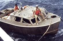 MT. MITCHELL survey launch -recovery efforts.Joe Dimartino, Chief Boatswain waiting for bow hook.# 12 of photo sequence