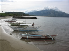 Fishing boats and dive boats at Pandan Island.