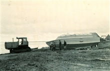 Launching survey boat with D-8 caterpillar at Nevat Camp.Arctic Field Party.