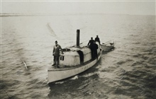 Steam launch towing skiff.