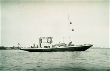 A charter boat used for current surveys in Boston Harbor.Current survey party of Ralph W. Woodworth.