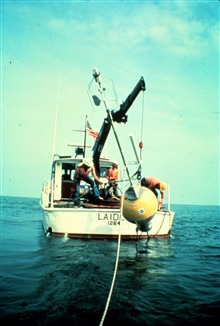 NOAA Research Vessel LAIDLY deploying oceanographic buoy.