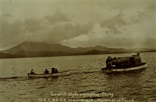 A survey launch towing a small boat.Boats off the MARINDUQUE.