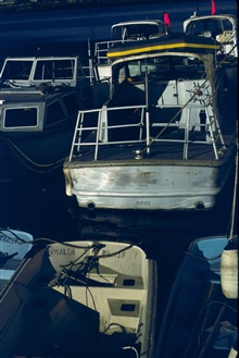 Jensen survey launches and small boats tied up at NOAA's Pacific Marine Center.
