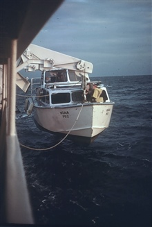 Out of the water and mousing the hook.LCDR Dave Waltz, bowhook.PEIRCE launch.Photo 4 of sequence