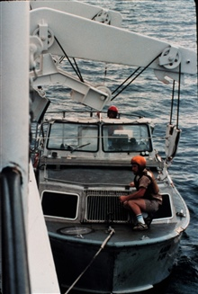 PEIRCE launch alongside ready for pickup.Lt. (j.g.) Marty Conricote ready to secure bow hook.