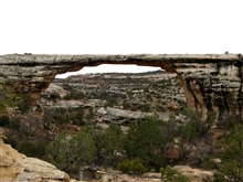A natural bridge formation generated by wind and water erosion.