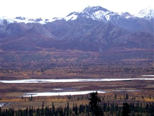 Mountains, valley and river in the fall.