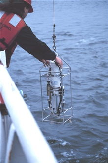 Deploying a CTD instrument from the NOAA Ship FERREL.