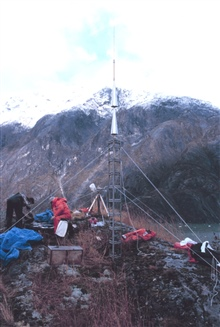 Lead Electronics Technician Bob Blackburn, Assistant Survey Tech Maureen Goff,and Assistant Survey Tech Scot Warrender at work setting up a GPS station atopSawyer Island