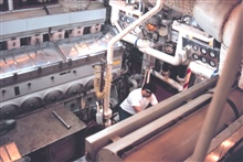 2nd Engineer Bill Ness at work in the RAINIER's engine room.
