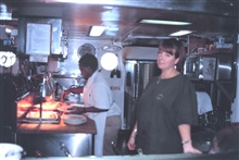 Chief Cook Doretha and 2nd Cook Sarah Satterfield prepare another fine meal inthe ship's galley.
