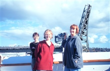 Happy crew members as the RAINIER approaches Lake Union ship base at the end ofa long surveying season.