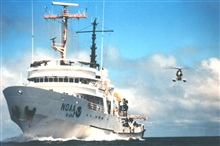 NOAA Ship DAVID STARR JORDAN and MD500 helicopter duringmarine mammal studies in the tropical east Pacific Ocean.