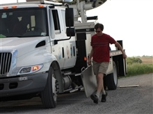 NSSL's Ted Mansell pulls out plates to help stabilize the NOAA X-Polmobile radar.