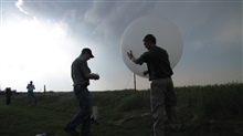 Bill Brown (NCAR) and Adam French (NCSU) prepare a balloon for launching.