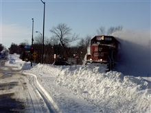 Freight Train taking on newly plowed roads.  Soo Line train at West North Avenue