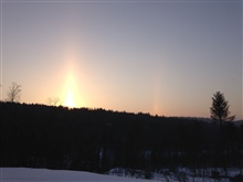 Sun pillar and sun dog before sunrise.