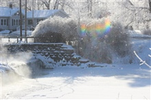 Frozen fog and falling snow meets rainbow.