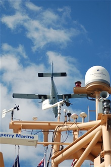 NOAA Twin Otter aircraft flying over NOAA Ship PISCES during Deep Water Horizondisaster.