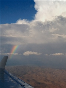 A rainbow seen over the Arizona desert from NOAA King Air (BC300 CER) N68RF.