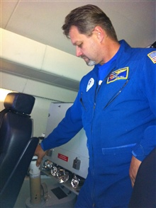 NOAA Engineer John Hill deploys a dropsonde from the G-IV during a February2013 mission over the North Pacific Ocean.