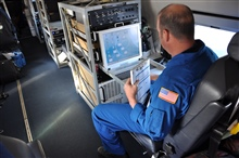 Lead Electronics Technician Gabriel Defeo aboard NOAA Gulfstream IVjet during February 2013 mission out of Honolulu_