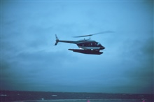 Lieutenant Budd Christman flying leased Bell 206 in Bering Sea.