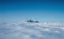 NOAA Ship SURVEYOR stuck in the ice of the Bering Sea southwest of PointBarrow. Bell UH-1M landing.