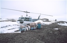 Unloaded Bell UH-1M helicopter with camp gear for bird studies in the PrudhoeBay area at remote camp site.  Welcome to the tundra!