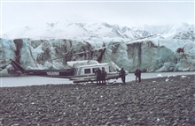 NOAA N58RF helicopter on ground by glacier front in South Central Alaska.