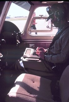 Lieutenant Dane Vose preparing for a snow survey background radiation collection flight in NOAA Rockwell International 500-S Shrike Commander