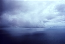 Rain squall over tropical Atlantic on a calm day.