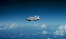 Both NOAA P-3's flying to a mission.