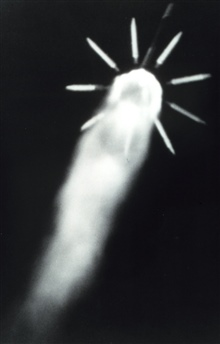 The nine solid rocket motors used to augment the thrust of Delta 116 are beingjettisoned 87 seconds after the launch at approximately 18 miles altitude.