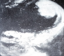 Two overlapping TIROS I images showing extratropical cyclone centered oversoutheastern Nebraska.   Associated cold front extends south into Gulf of Mexico.  Monthly Weather Review, September-December 1960, p. 317.