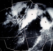 Gridded photograph of Frame 7 from the TIROS I pass 659.  Cloud masses A and Bwere associated with severe weather.  Cloud mass B spawned tornadoes near theIllinois-Missouri border.  Monthly Weather Review, November 1961, p. 449.