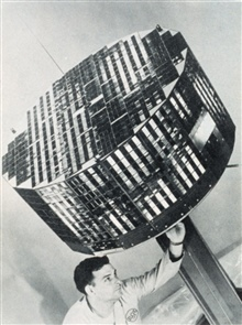 Making adjustments to TIROS II satellite prior to launch.  Small square objectsare 9,260 solar cells.  TIROS II was the first meteorological satellite to haveinfra-red sensors as well as television cameras.  It was launched November 23,1960 and weigh