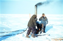 Using a boiler to melt the permafrost for setting a triangulation marker