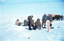 Baseline measurements on the lagoon ice - note stakes along line