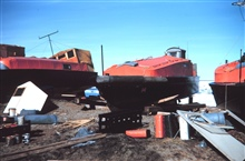 Survey launches at Tigvariak Island ready for a summer season of workBoats painted orange for visibility in Arctic waters
