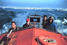 Cruising through an ice field - l to r - Ted Shanahan, Stan Jeffers,Jerry Gray, and Simon Tagarook