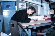 Harley Nygren working on a hydrographic survey sheet on Survey Launch #15